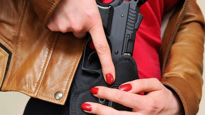 Woman with holstered gun; image courtesy of www.gunowners.org.