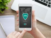 Person accessing VPN on smartphone; image courtesy of www.engadget.com.