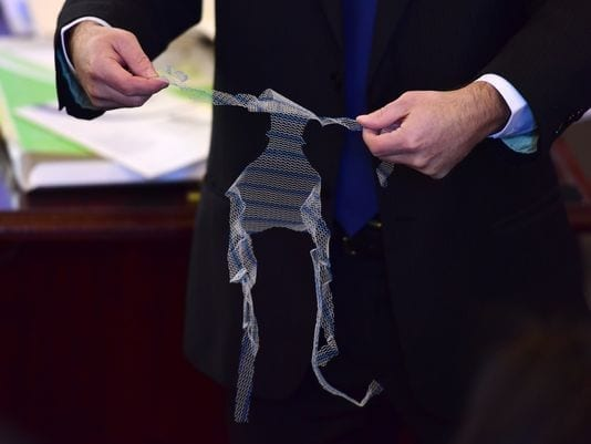 Adam Slater, attorney for the plaintiffs, Elizabeth and Tad Hrymoc, holds the product Prolift, which the plaintiffs say is faulty. Photo: Tariq Zehawi/NorthJersey.com; caption by NorthJersey.com.