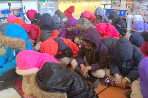 Elementary school kids wearing coats to class in Baltimore.