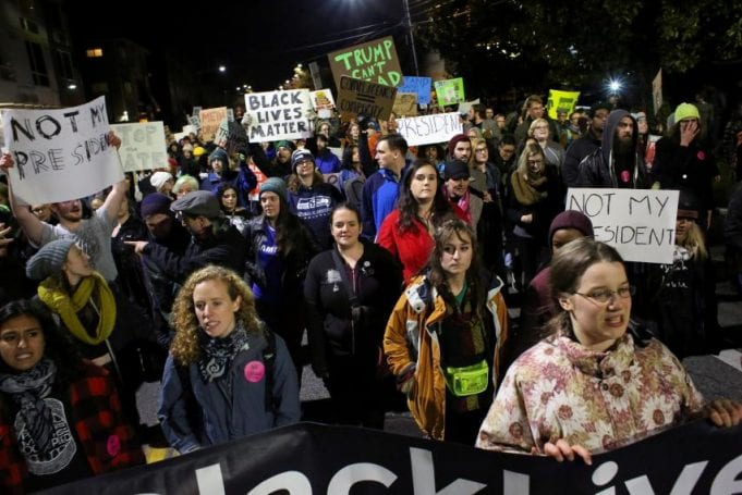 Demonstrators march through the Capitol Hill neighborhood during a rally against U.S. President-elect Donald Trump in Seattle, Washington, U.S. November 20, 2016. REUTERS/David Ryder via www.newsweek.com.