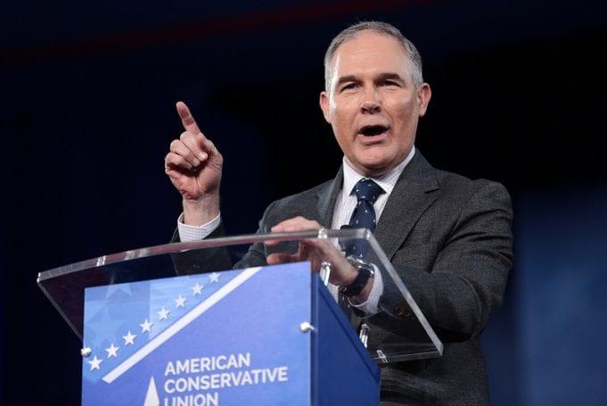 "EPA head Scott Pruitt speaking at a podium, which reads, ""American Conservative Union."""