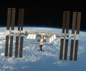 The International Space Station, backed by the Planet Earth.