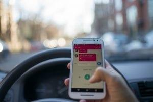 Texting while driving; image by Roman Pohorecki, via Pexels.com, CC0.