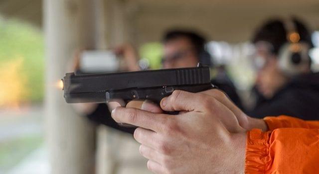 Man firing handgun; image by Peretz Partensky, via Flickr, CC BY-SA 2.0, no changes.