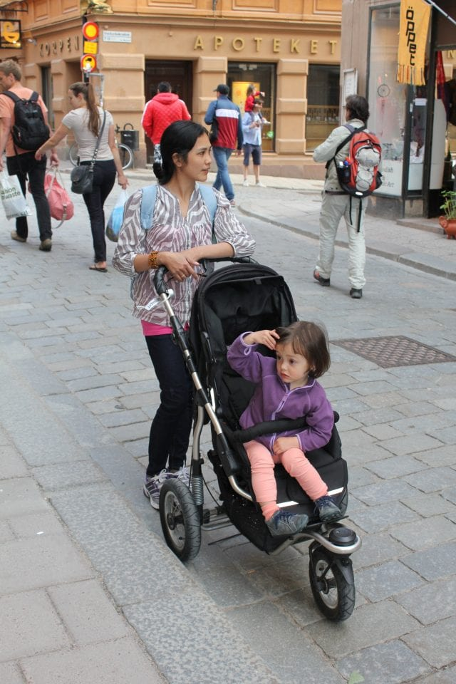 image of a child being pushed in a stroller