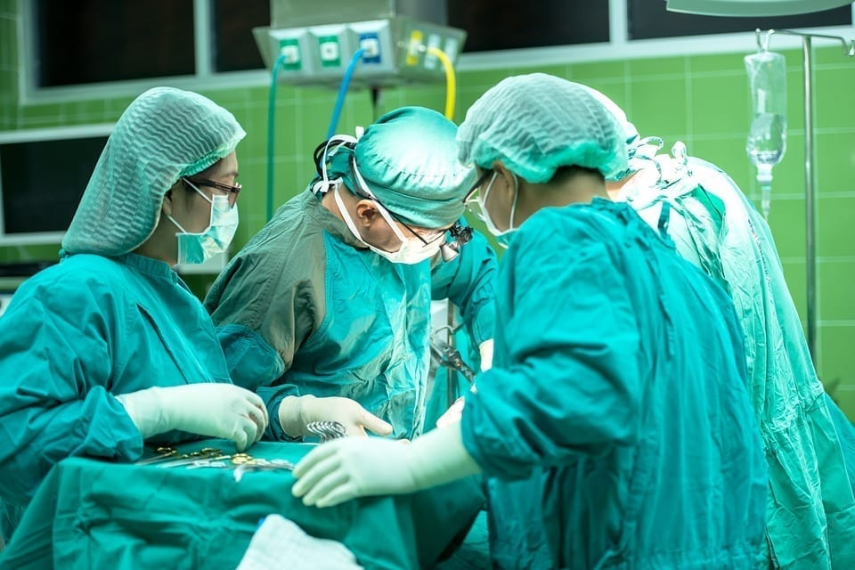 Image of doctors performing a surgery