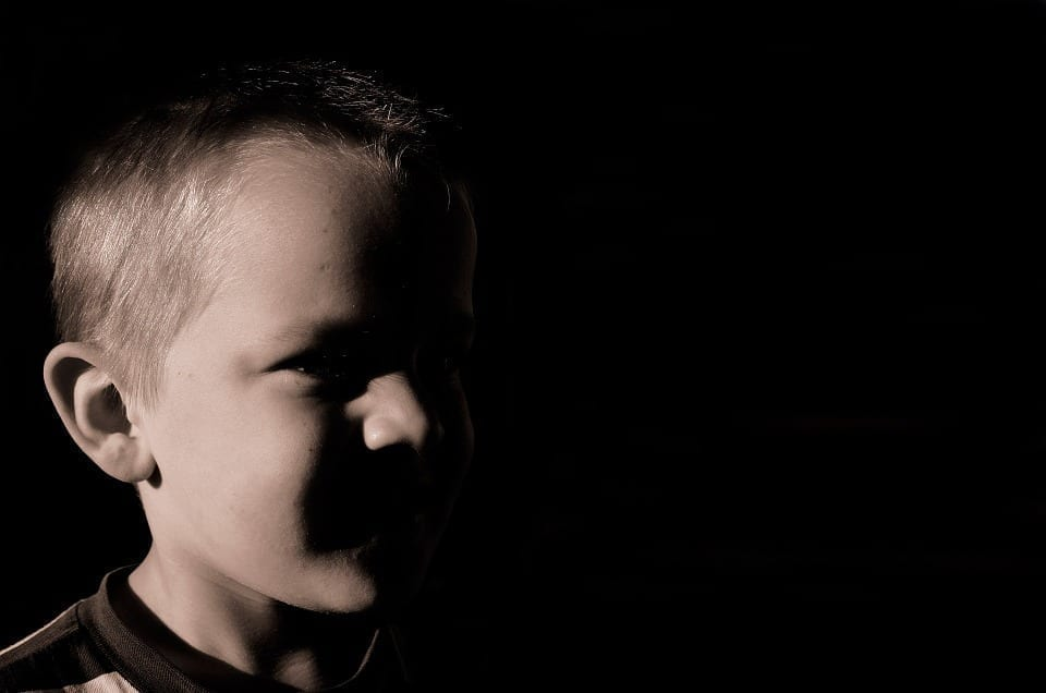 Image of a young boy in the shadows