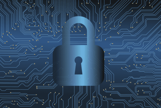 A padlock superimposed over a blue circuit board pattern.; image by jaydeep_ CC0, via Wikimedia Commons.