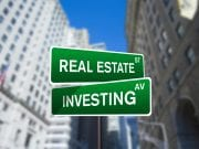 Real estate investing street sign on Wall Street; image by Investment Zen via Flickr, CC BY 2.0, no changes.