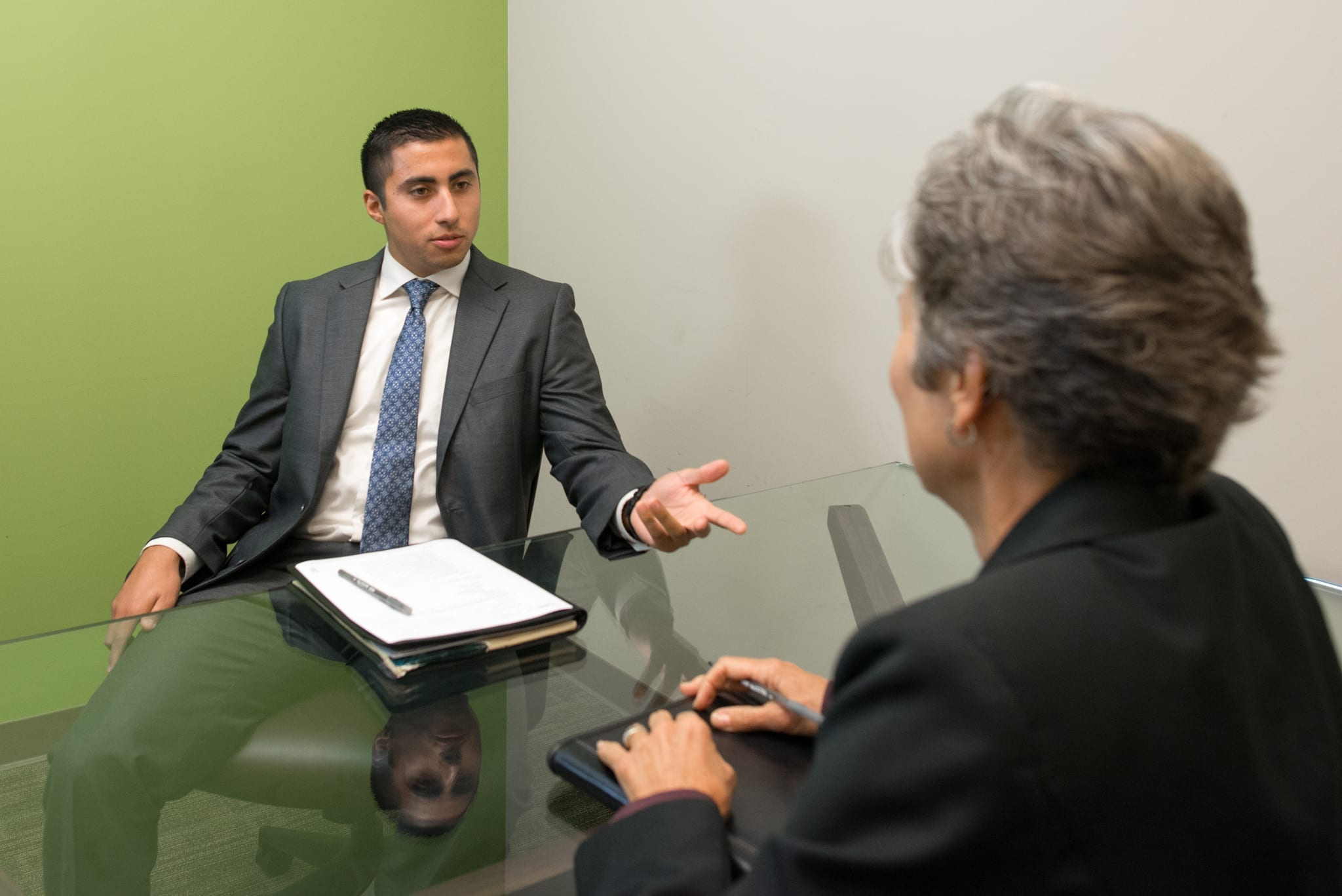 Man on a job interview; image courtesy of Amtec Staffing, via Flickr, CC BY-SA 2.0, no changes.