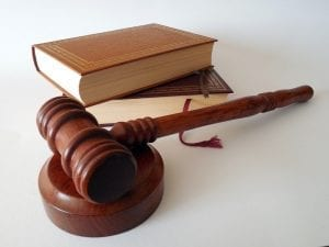 image of a legal gavel and books