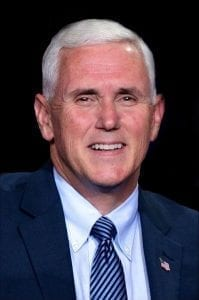 A portrait of Vice President Mike Pence, wearing a suit with a striped blue necktie.