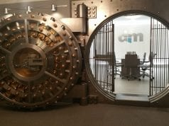 Open vault with conference table and chairs inside; image via Pxhere, CC0.