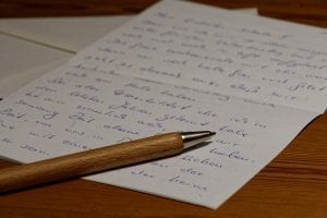 Wooden pen and letter; image via Pxhere, CC0.