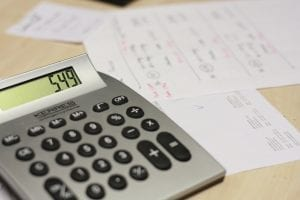 Calculator and paperwork; image via Pxhere, CC0.