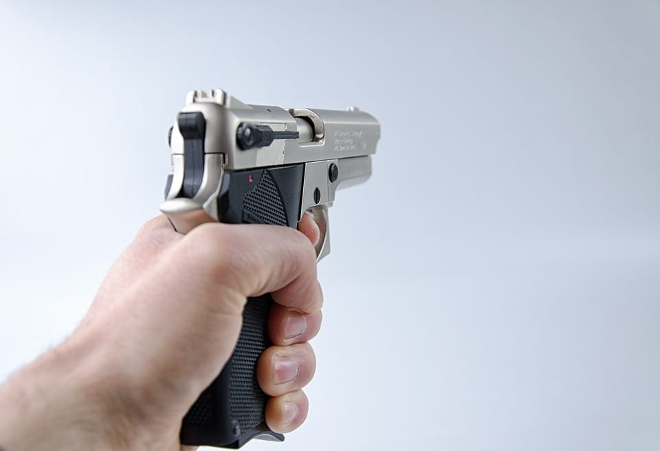 Image of a person holding a gun