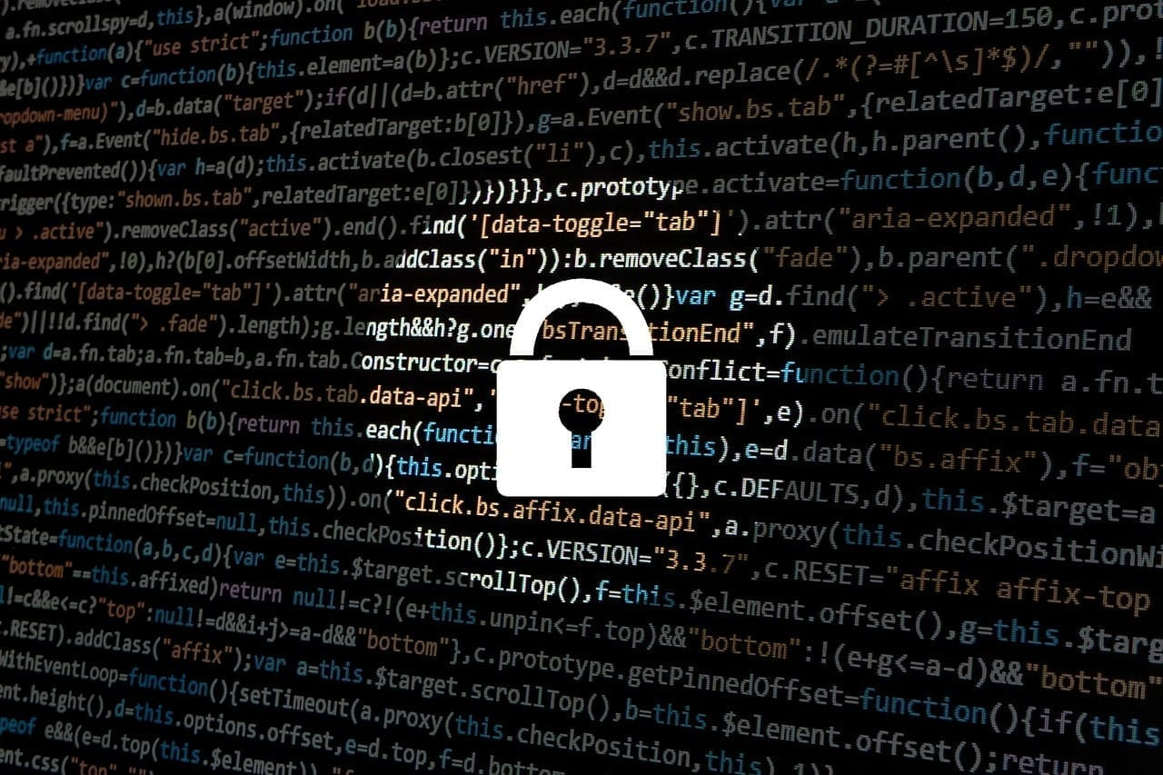 Computer screen filled with lines of code and an image of a padlock; image by typographyimages, via Pixabay, CC0.