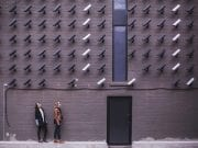 Multiple cameras tracking two women outside a building; image by matthew henry 87142 via unsplash.