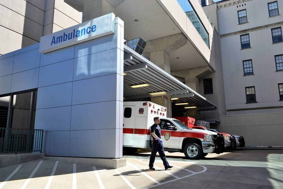 Image of an emergency room and ambulance