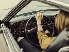 Image of a female driver in her car