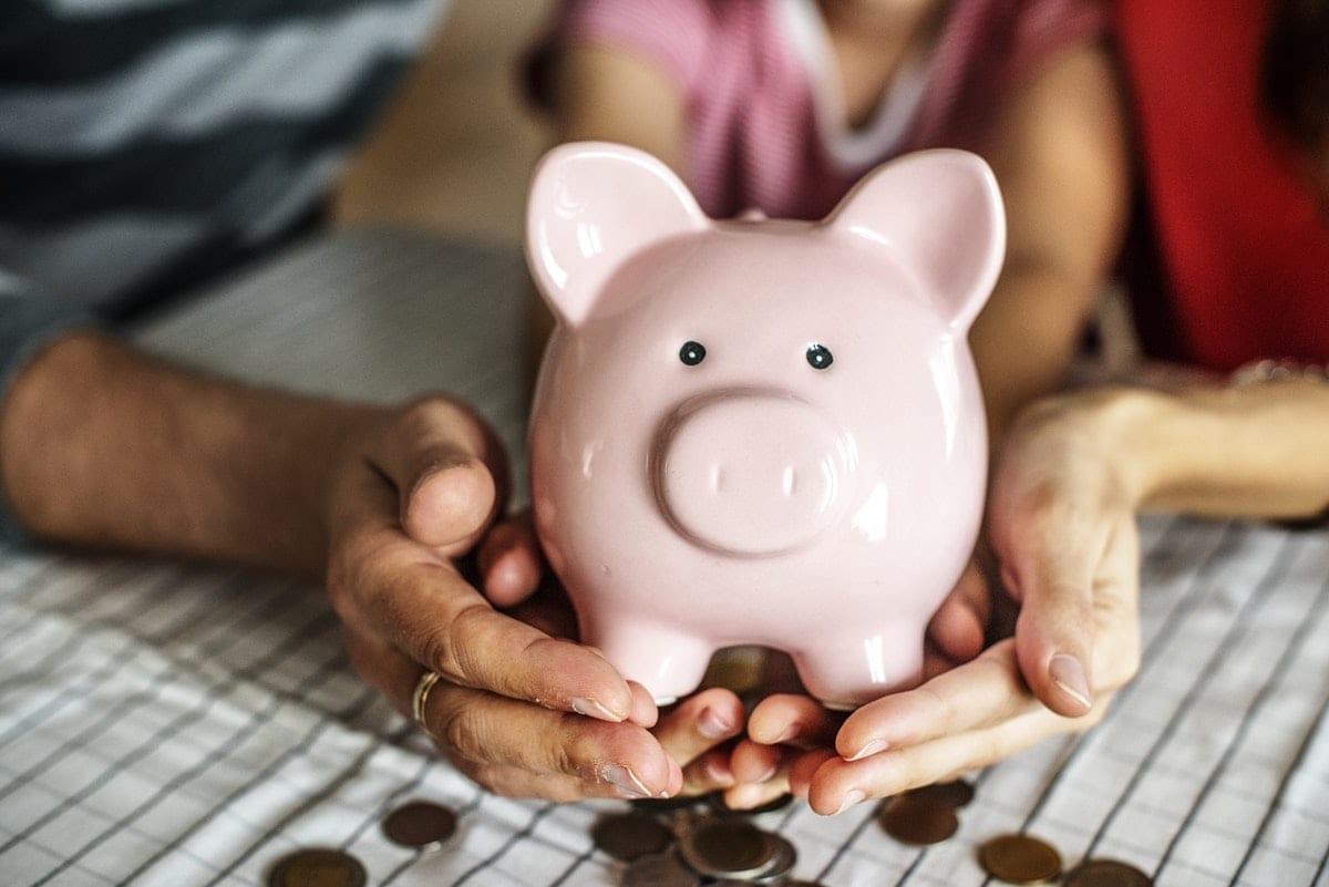 Kid saving money for future; royalty free image on RawPixel.