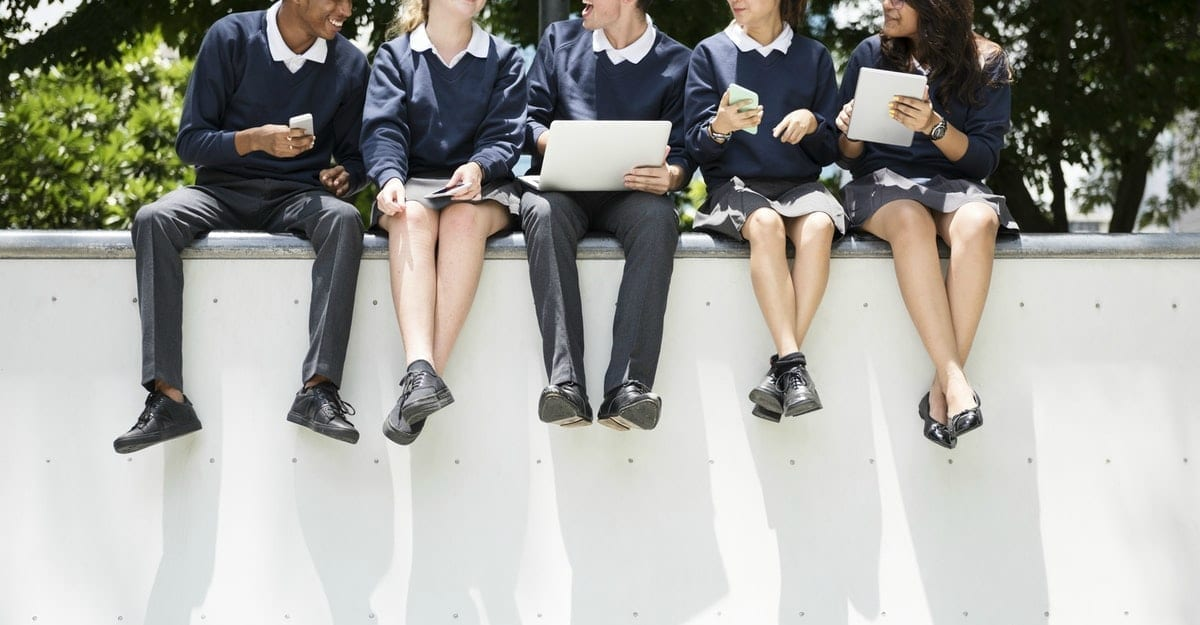 Students doing homework in the park; royalty free image on RawPixel.