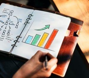 Marketing plan in a planner; image by rawpixel.com, via Unsplash.