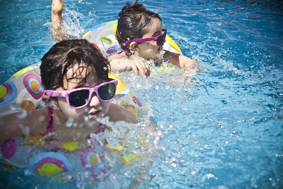 Image of Children Swimming in a Swimming Pool