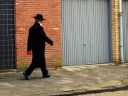 Image of an Orthodox Jew Walking Down a Sidewalk