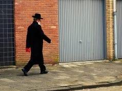 Image of an Orthodox Jew Walking Down a Sidewalk