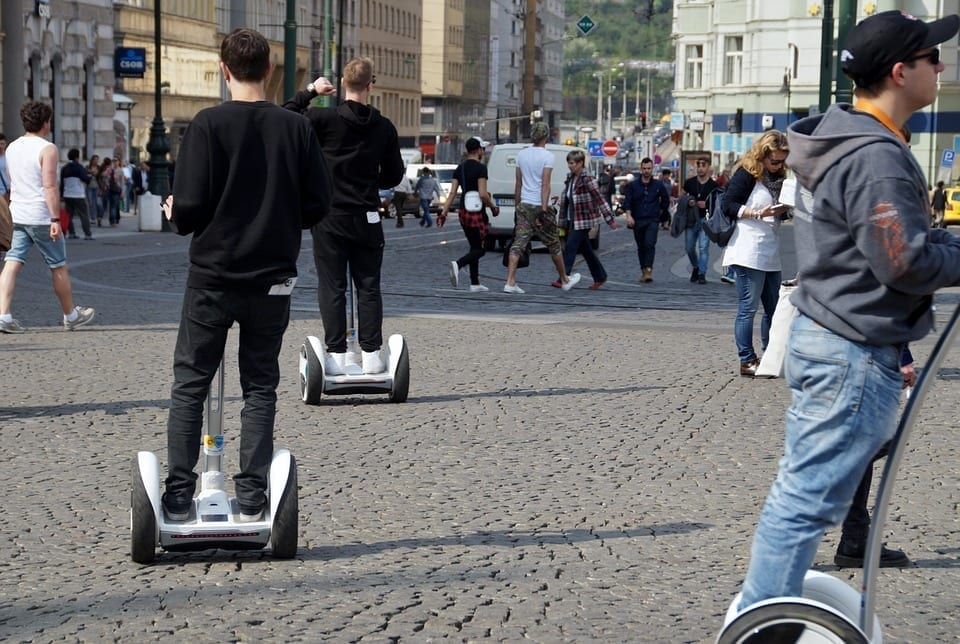 Image of People Riding Electric Scooters