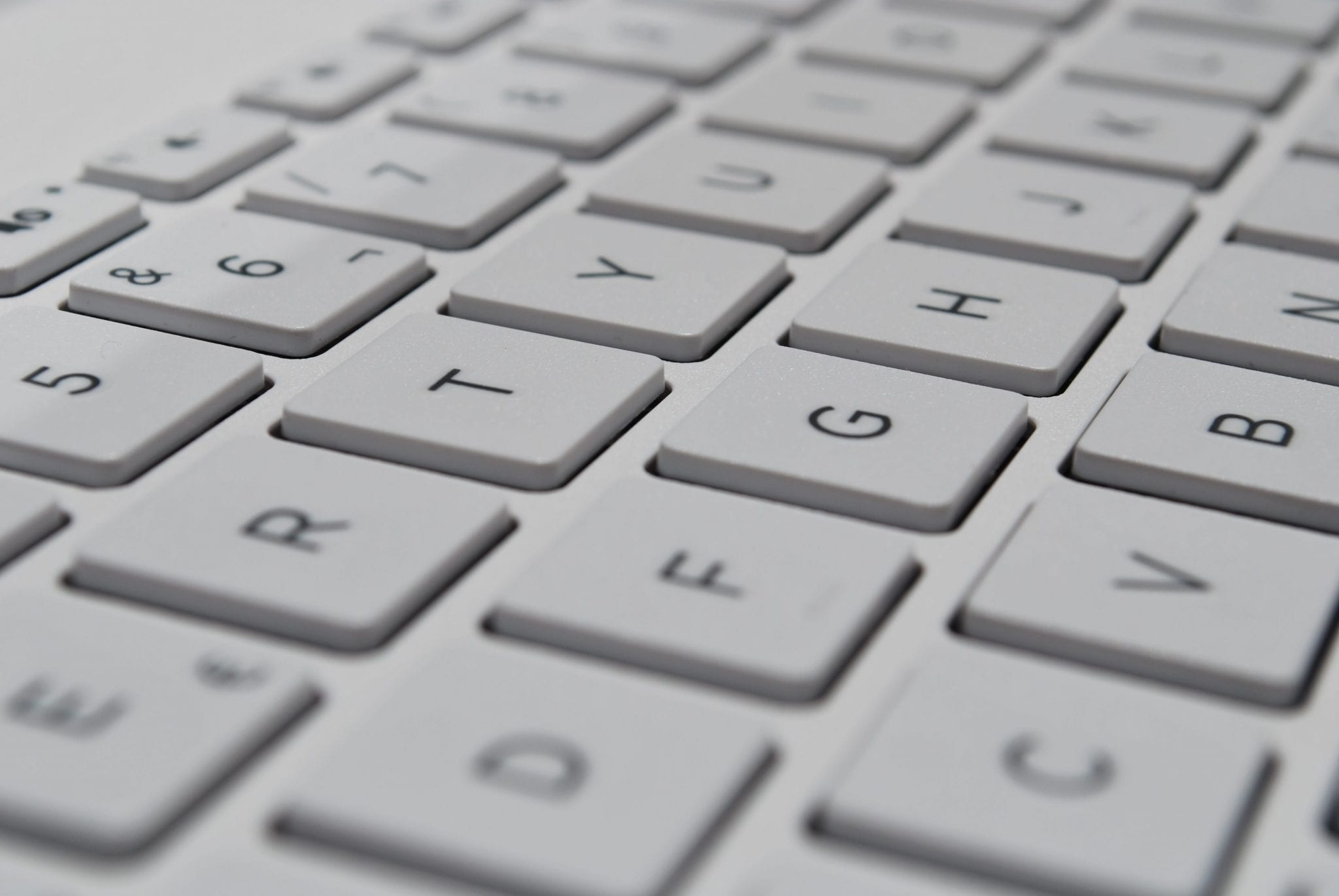 Computer keyboard; image by Sergi Kabrera, via Unsplash.com.