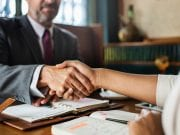 Two people shaking hands; image by Rawpixel, via Unsplash.com.