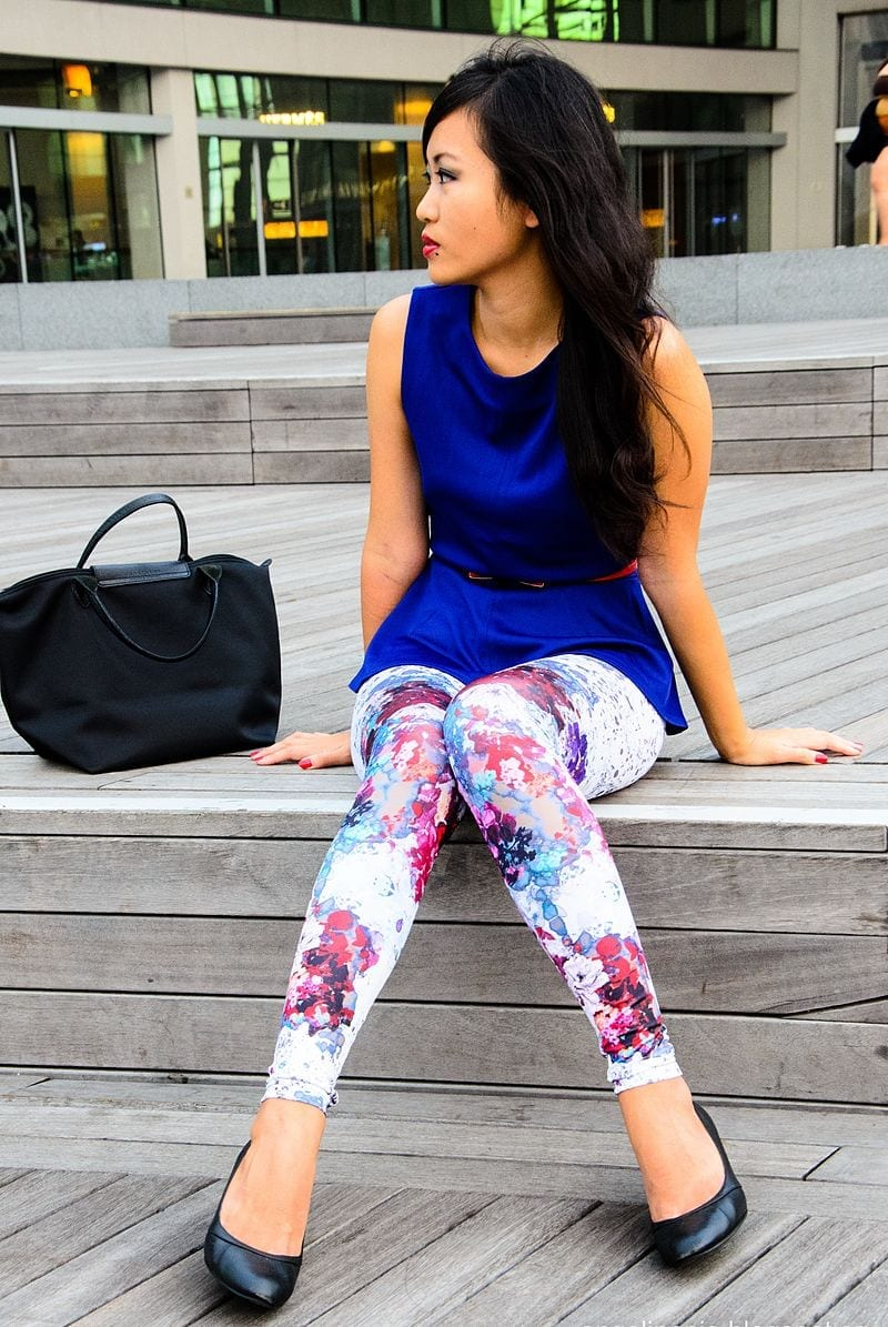 Image of A woman wearing brightly colored leggings