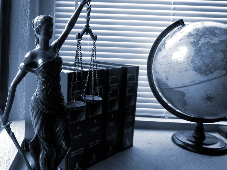 Image of Lady Justice and Legal Books