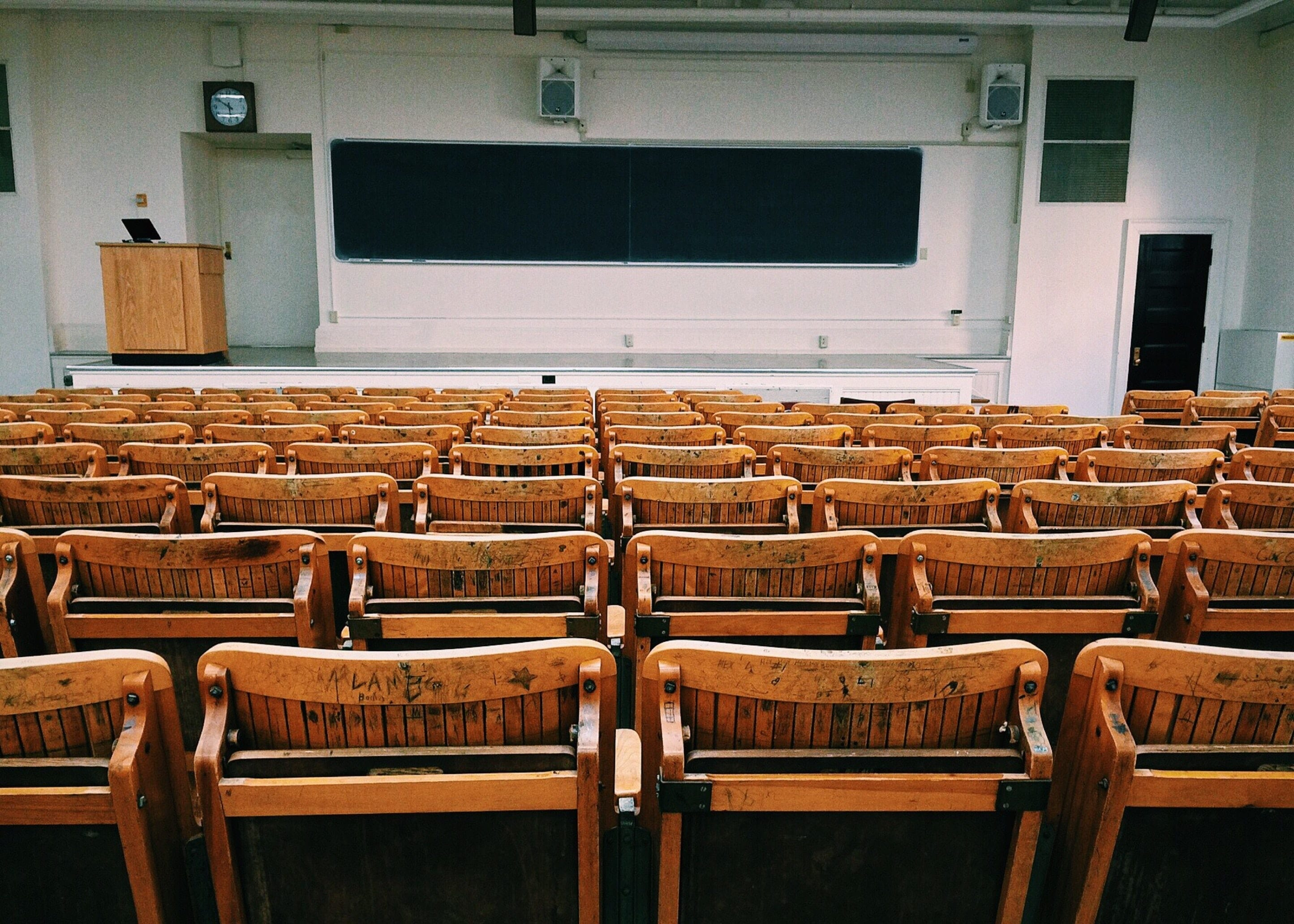 Empty classroom with chairs facing chalkboard; image by Pixabay.com, via Pexels.com, CC0.