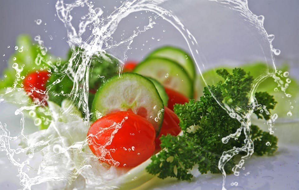 Cherry tomatoes, sliced cucumber, and parsley tossed in water; image by Sonchia, via Pixabay.com, CC0.