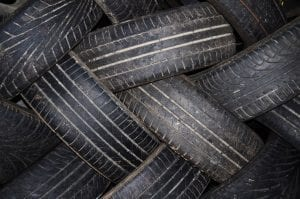 Stack of old tires arranged in a criss-cross pattern; image by George Hodan, PublicDomainPictures.net, CC0.