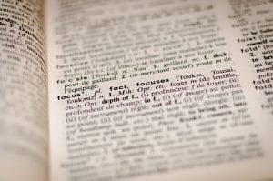 """Dictionary page with the word """"Focus""""; image by Romain Vignes, via Unsplash.com."""