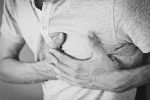 A man clutching his chest