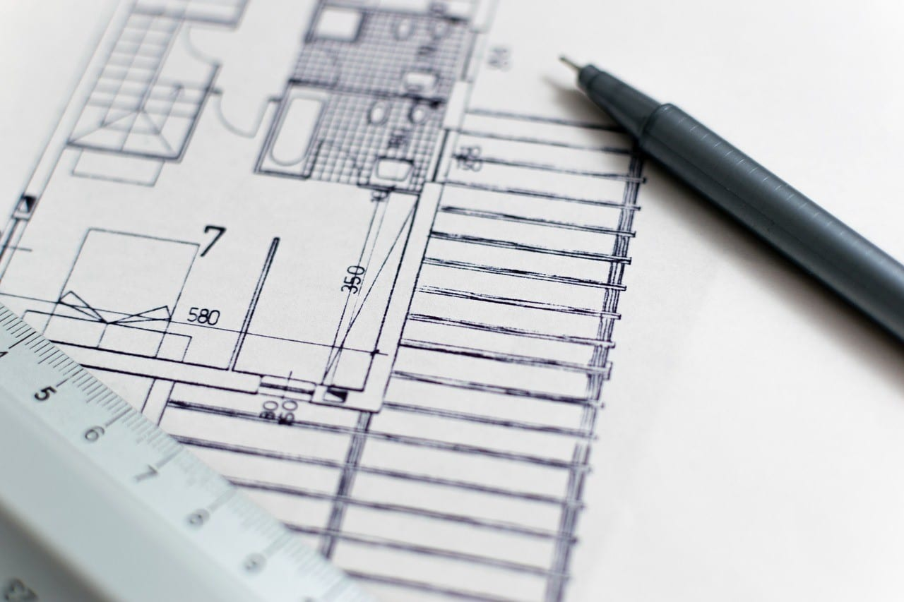 Blueprint, ruler, and drafting pen; image via Pexels.com.