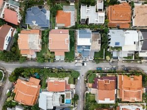 Aerial view of a neighborhood; image by chuttersnap, via Unsplash.com.