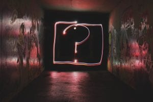Neon question mark sign; image by Emily Morter, via Unsplash.com.