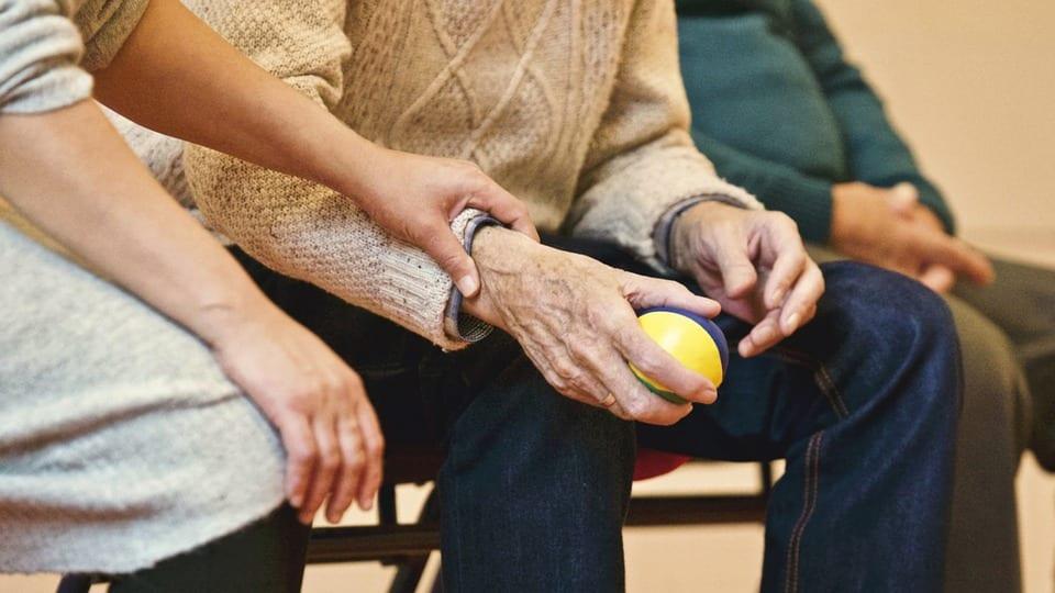 Elderly man and woman sitting