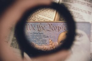 "Soft focus of a magnified line from the U.S. Constitution - ""We the People."" Image by Anthony Garand, via unsplash.com"