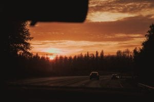 Cars driving in sunset; image by Mat Reding, via unsplash.com.