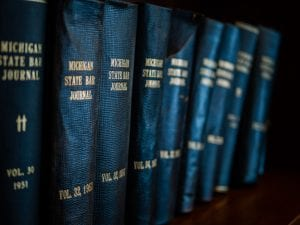 Michigan State Law Journals on bookshelf; image by Rob Girkin, via unsplash.com.