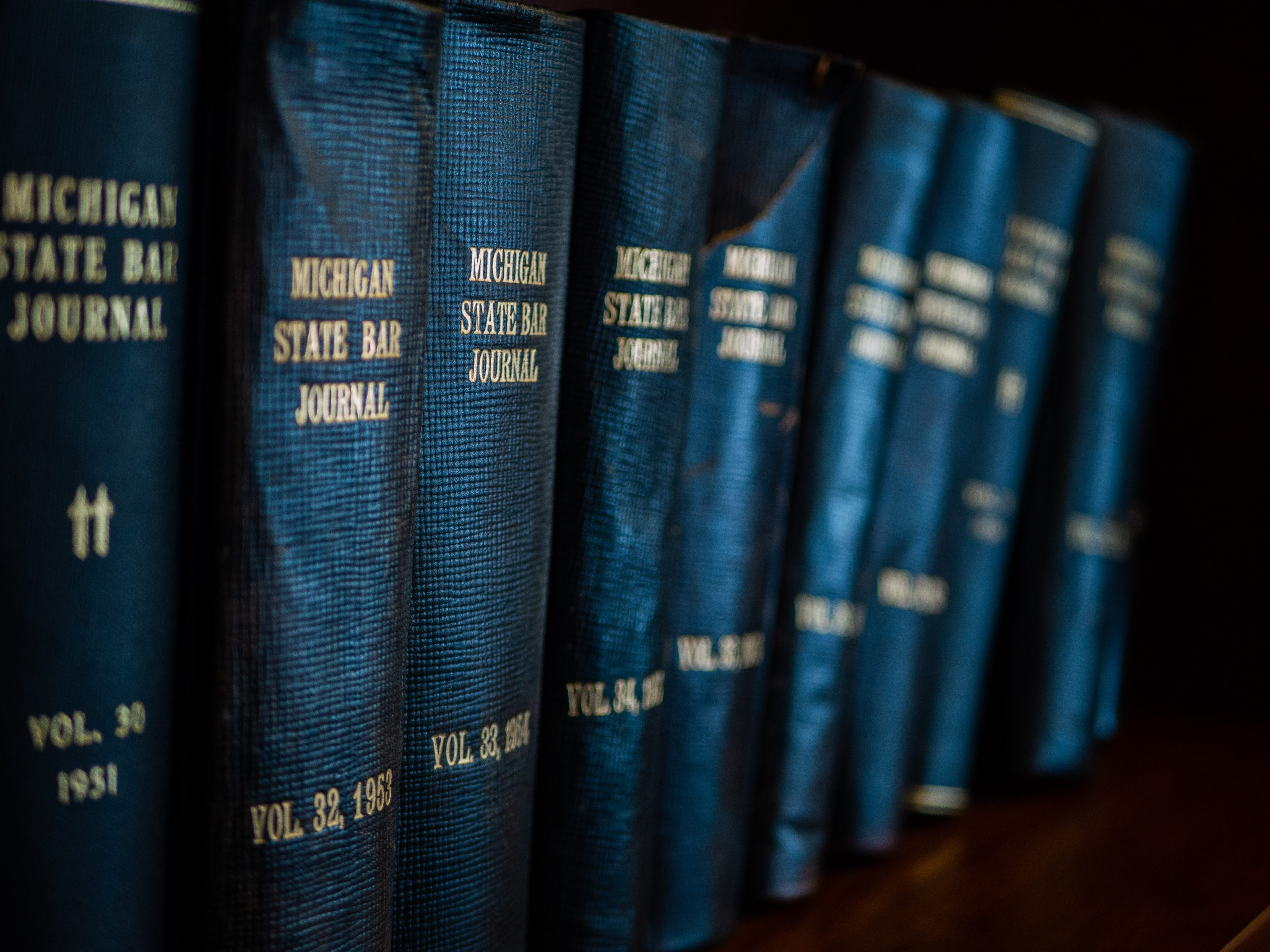 Michigan State Law Journals on bookshelf; image by Rob Girkin, via unsplash.com.