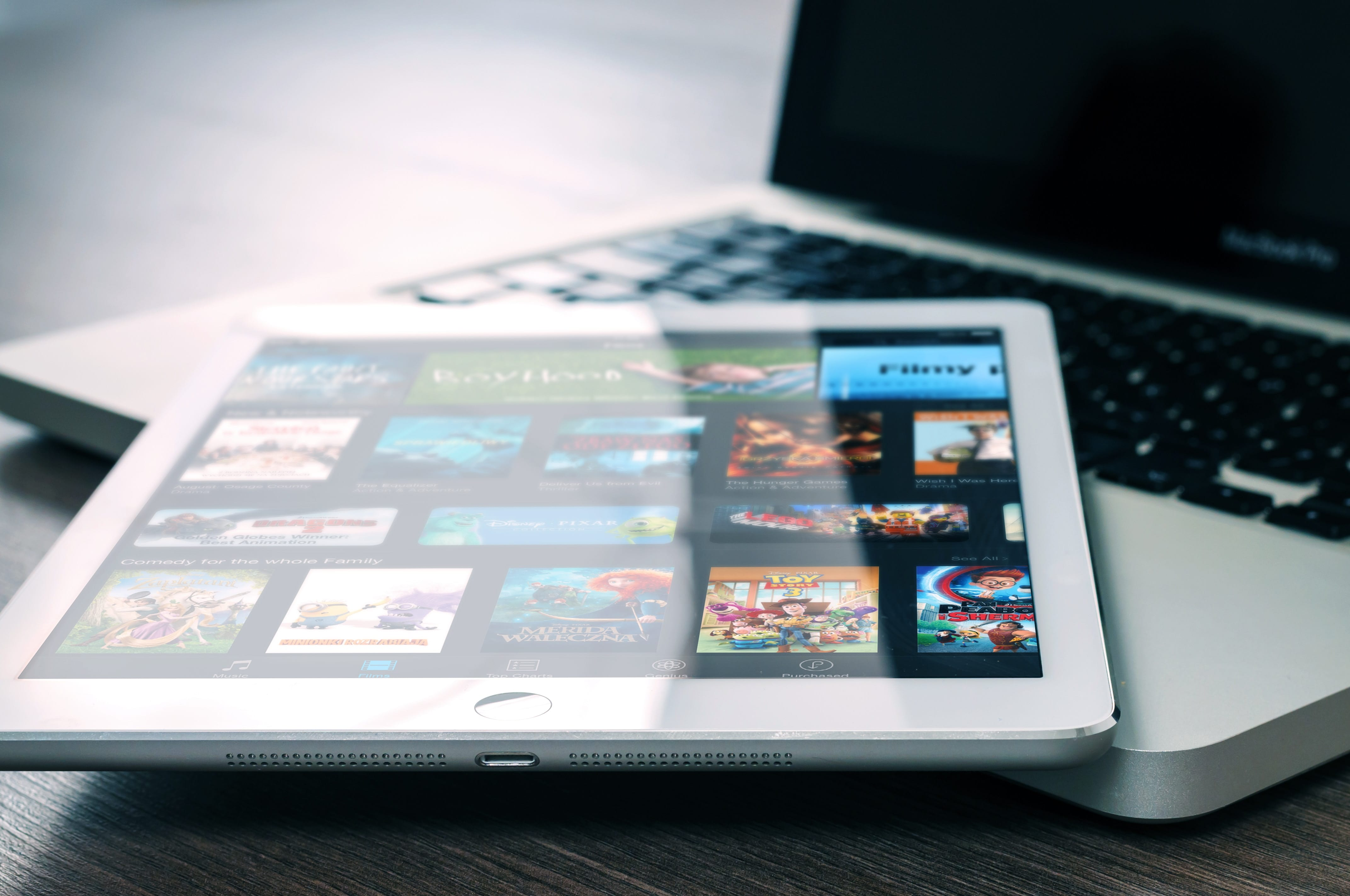 Tablet computer on top of a laptop; image by William Iven, via unsplash.com.